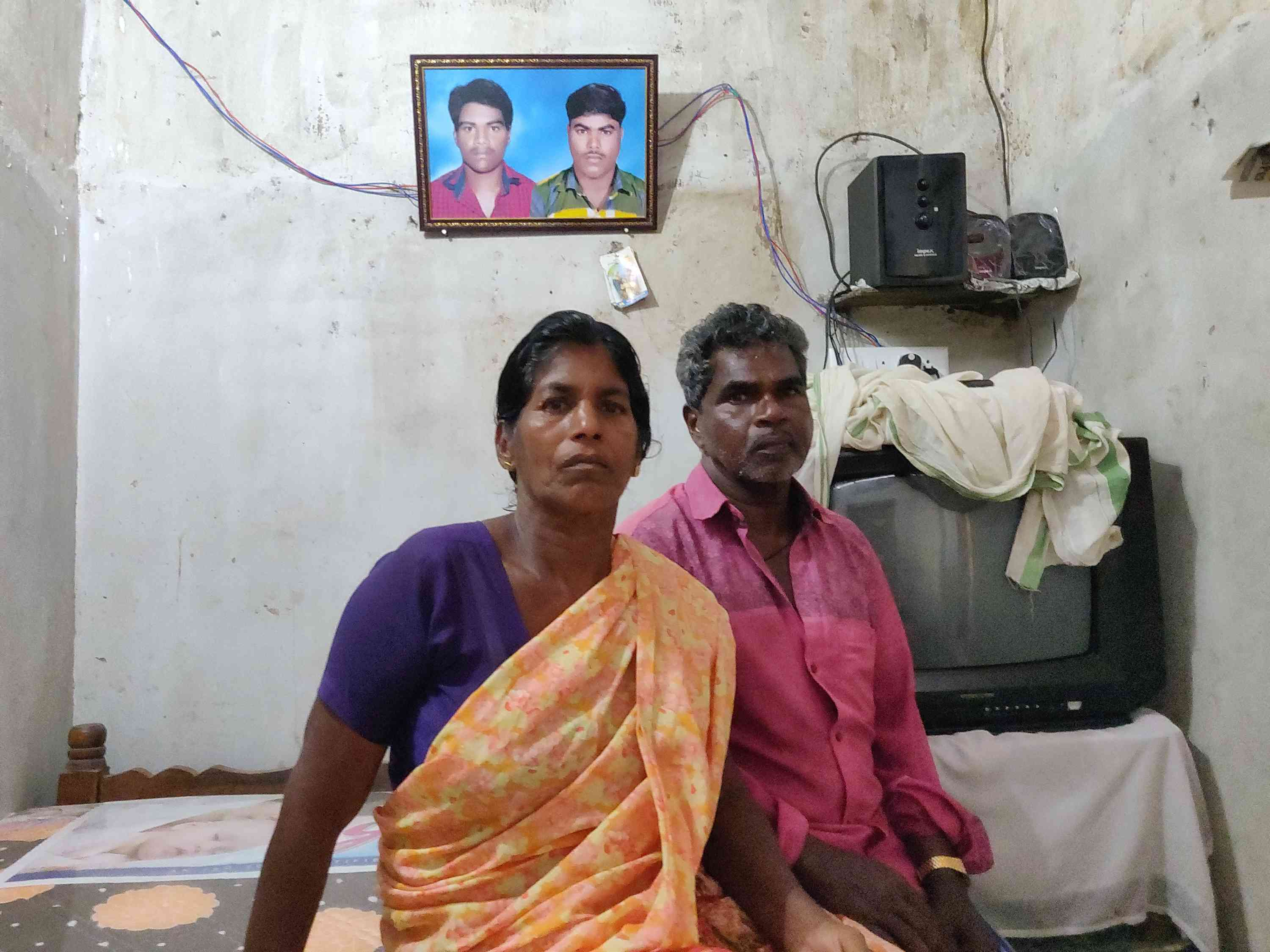 Muthappan Aralappan and Elsy at their rented home in Vizhinjam. A photo of their son John Muthappan and his cousin Rajan Lawrence – both of whom died in Cyclone Ockhi – hangs on the wall.