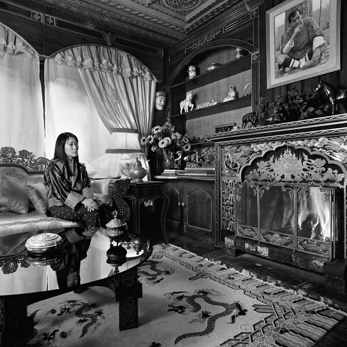 Her Majesty The Queen of Bhutan, Ashi Dorji Wangmo Wangchuck, at home in her palace in Thimphu. Image by Serena Chopra. Courtesy Tasveer.