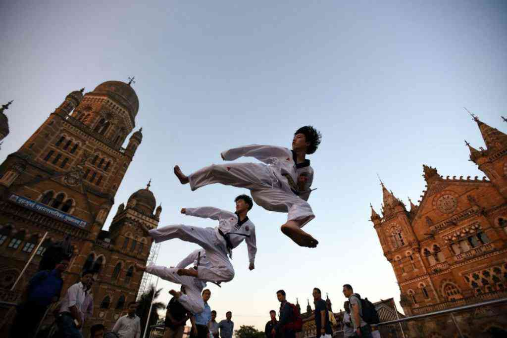 Members of the Korean Taekwondo demonstration team put up a show at the 'selfie zone' opposite the Chhatrapati Shivaji Maharaj Terminus. Photo credit: Deepak Turbhekar/Mumbai Mirror.