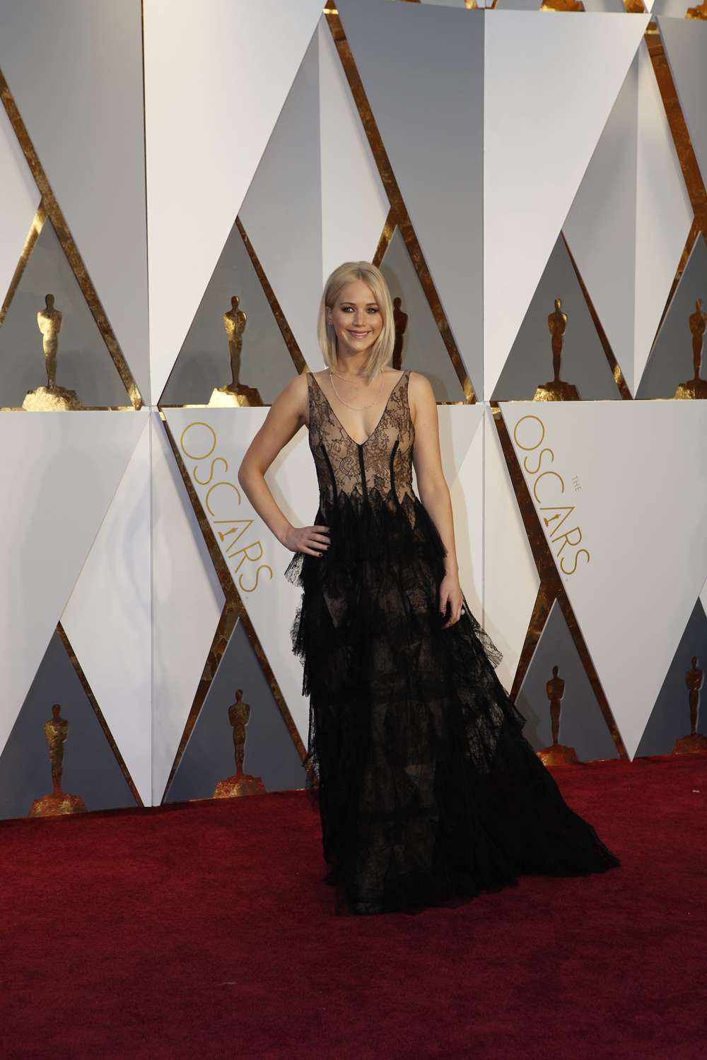 Jennifer Lawrence in a black and nude flowing Dior gown.