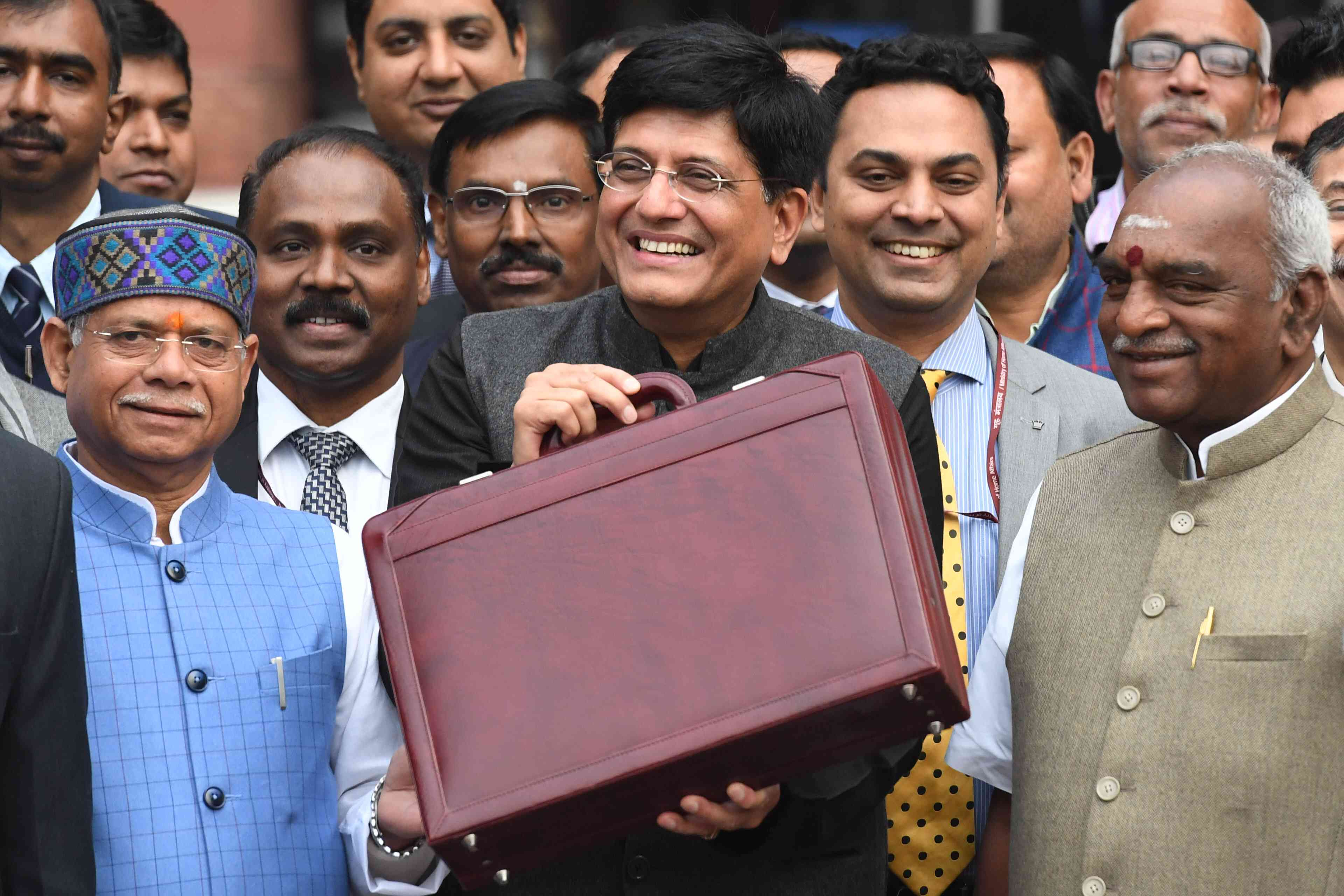 Finance Minister Piyush Goyal with the briefcase containing the Budget documents ahead of the presentation at 11 am on Friday. (Credit: Prakash Singh/AFP)