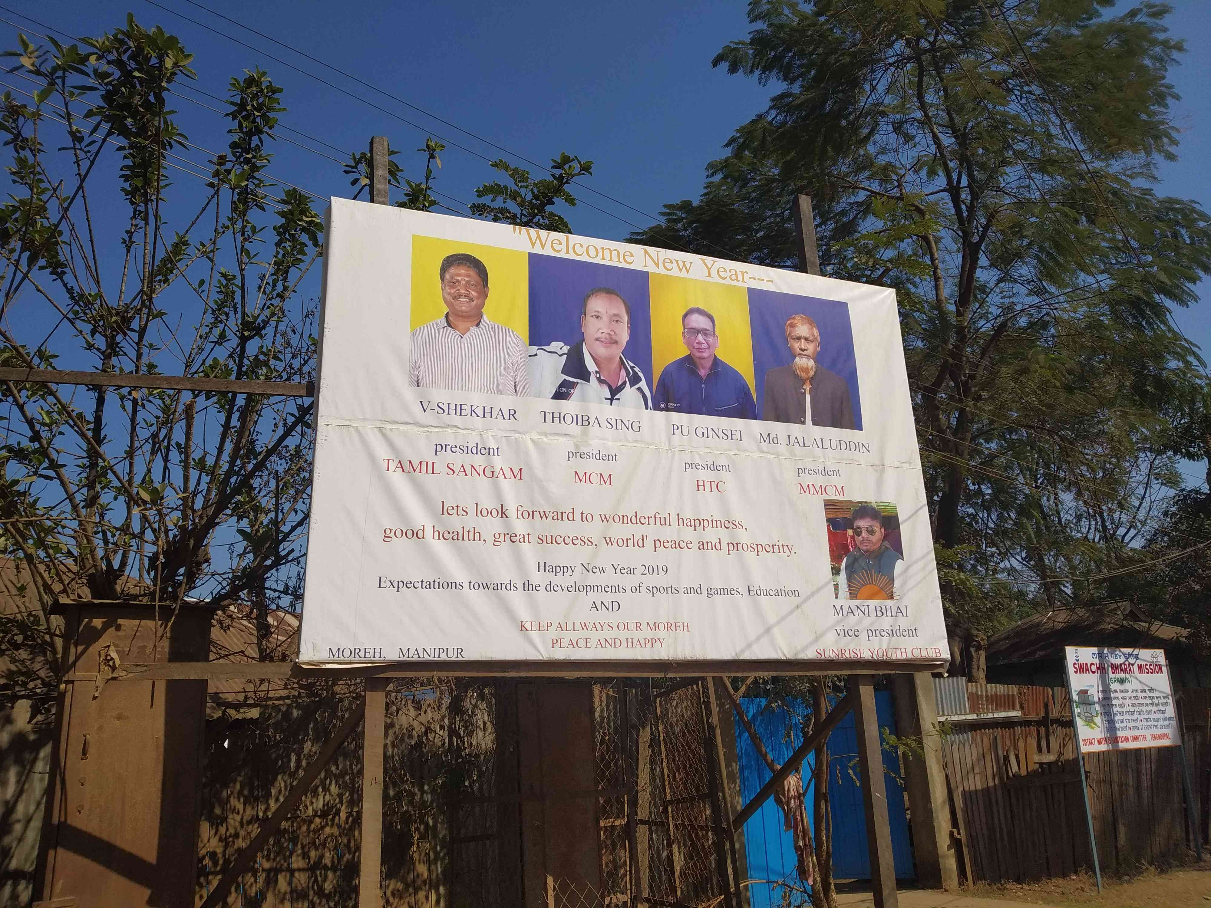 A hoarding in Moreh depicts the leaders of the town's four major communities. Photo credit: Arunabh Saikia