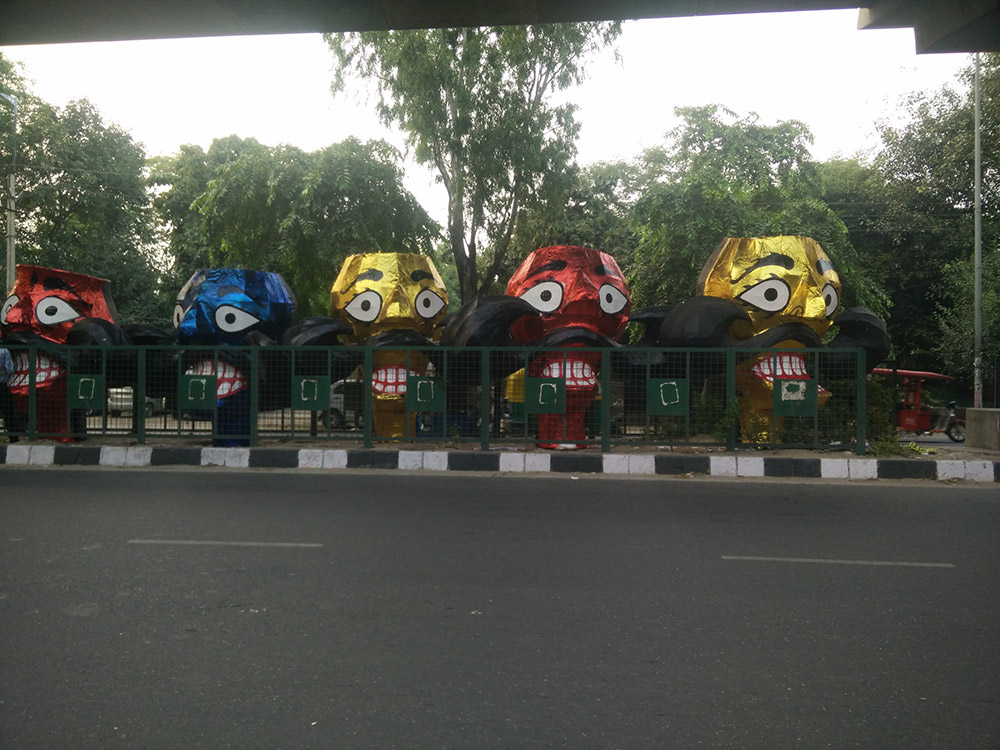 Decked up Raavan heads keeping each other company on a road divider. Photo: Rhema Mukti Baxter