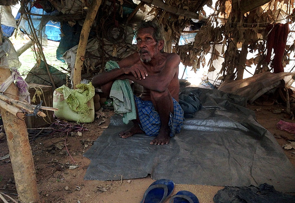 Chintaman Malhar's neighbour in his hut. All the houses in the settlement are made of dried leaves and plastic. (Photo credit: Swati Narayan)