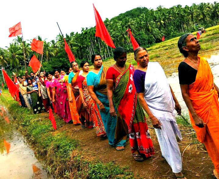 Women residents of Keezhattoor village in Kannur march on Thursday holding Communist Party of India (Marxist) flags after ending their agitation against a proposed bypass. (Credit: Special arrangement)