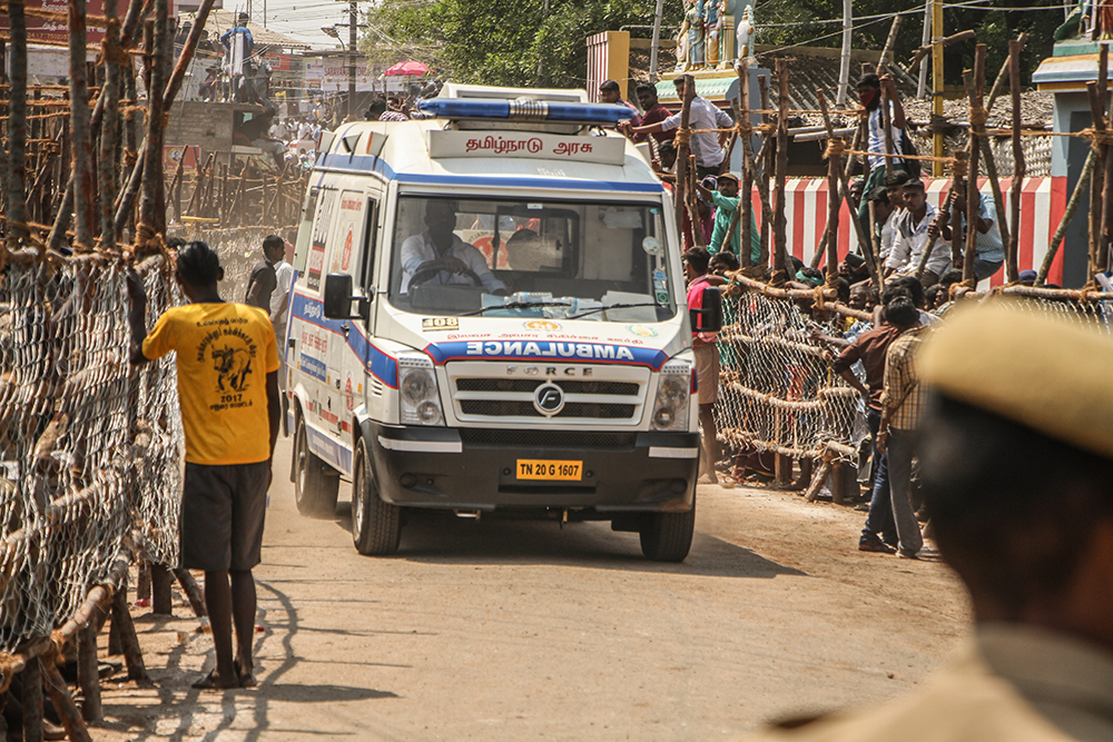 An ambulance rushes from the ground at Alganallur, carrying an injured player. Anticipating possible casualties, ambulances and a number of medical teams are stationed at the arenas.