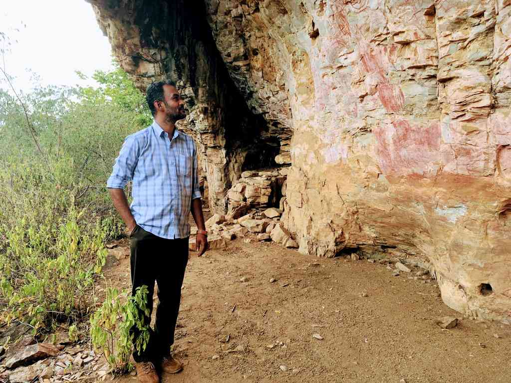 Koshy admires the stunning rock art in the ravines of the mesa.
