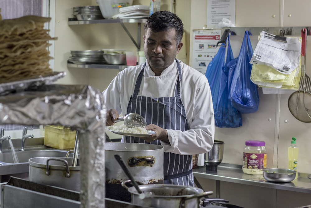 Asker, the head chef at the India Club Bar and Restaurant, came to London 20 years ago from Kerala. Along with his colleague and friend Khaled, he never thought of working anywhere else other than the historic India Club. The menu offers a range of home-cooked Indian dishes and his version of the mango lassi is a favourite with customers. Photo: Paroma Mukherjee/England
