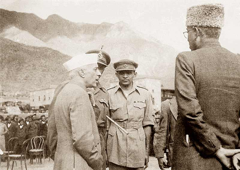 Jawaharlal Nehru and Sheikh Abdullah discussing military plans with Brigadier Mohammad Usman, Commander of 50 Para Brigade