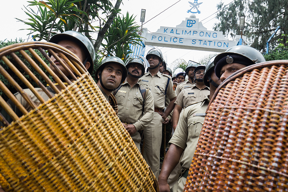 Police men stand guard during a rally in Kalimpong on June 15. Photo: Praveen Chettri