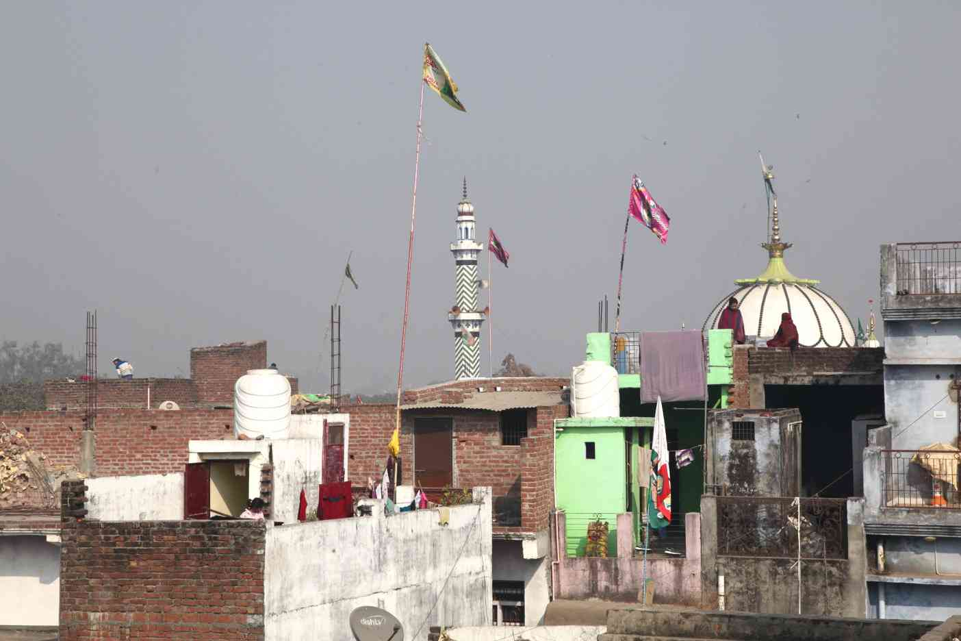 After the communal riots of 2012, flags went up on homes to mark the religious identity of the occupants.