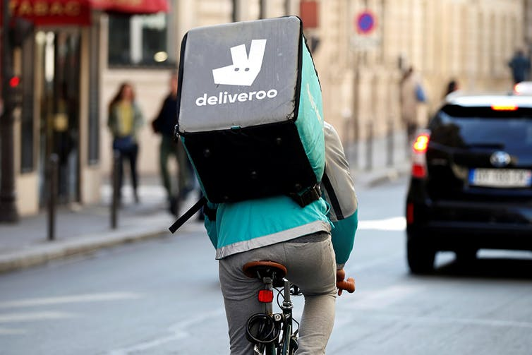 Almost a quarter of Americans said they earned money from the gig economy in 2016. Photo credit: Charles Platiau//Reuters
