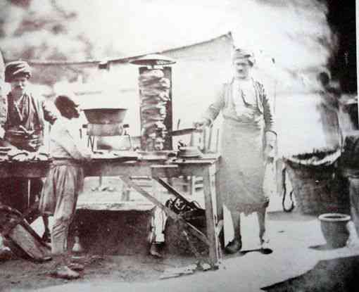 The earliest known photo of thedoner kebab, meat cooked on a vertical rotisserie, taken in the Ottoman Empire in 1855. Photo credit: James Robertson/Wikimedia Commons [Licensed under CC BY Public Domain]