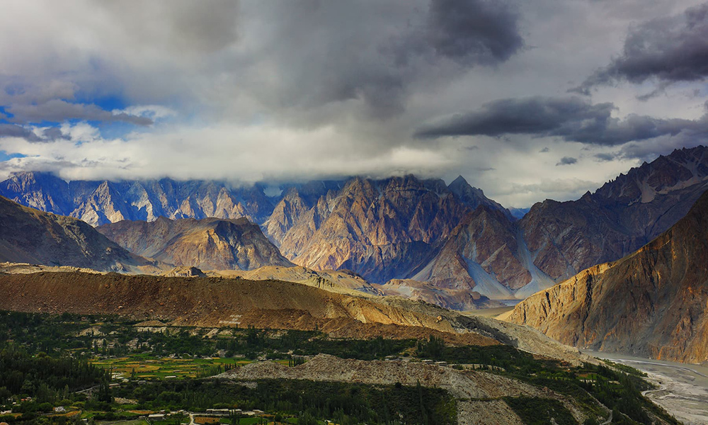 The last rays of the sun shining on Passu Cones in Gulmit village.