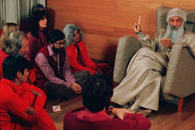 Sheela (bottom left) was officially appointed Rajneesh's personal secretary in 1981.Photo credit: Keystone