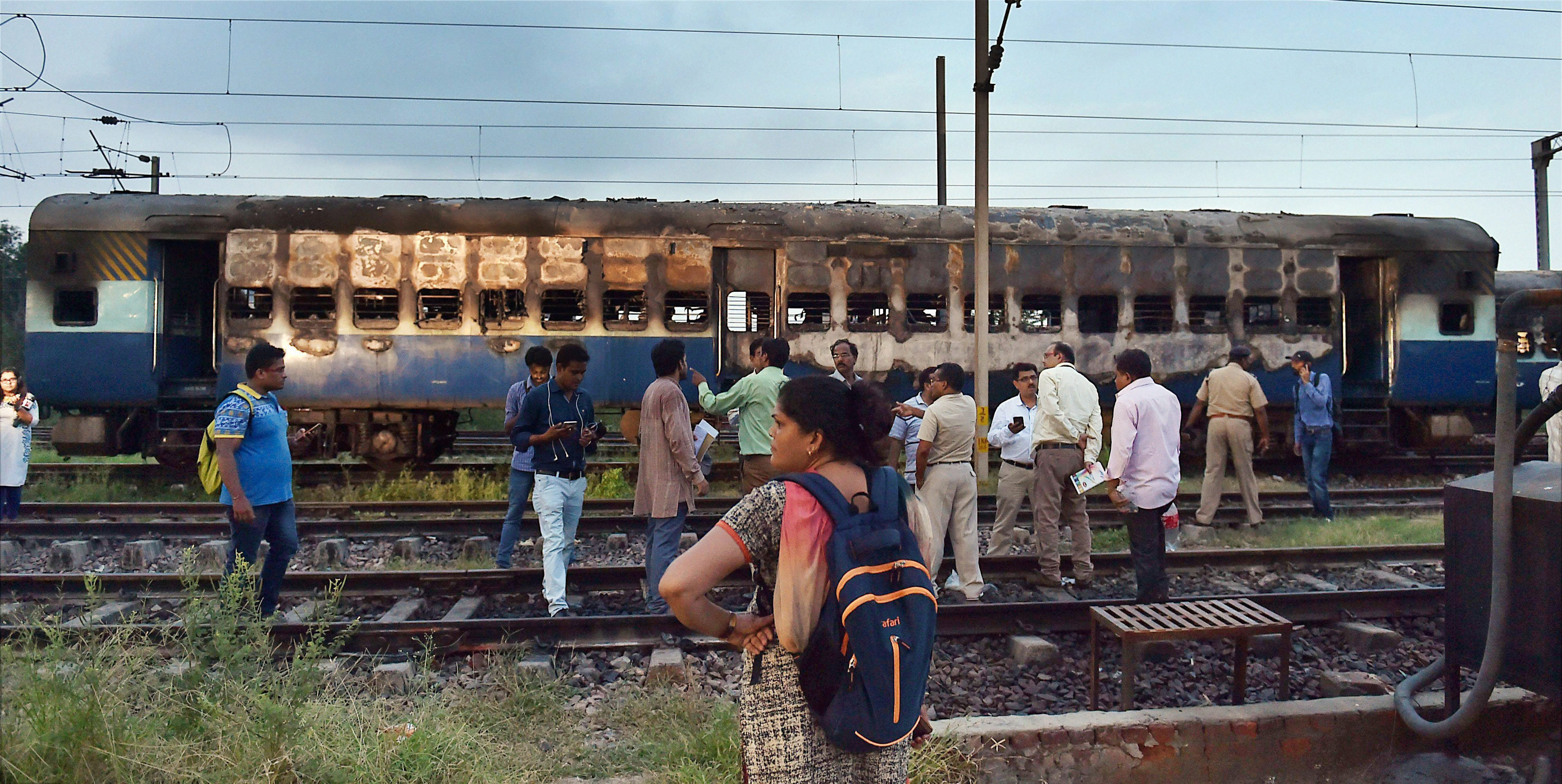 Dera Sacha Sauda followers vandalised and set on fire several coaches of trains at Delhi's Anand Vihar Station. (Credit: PTI)