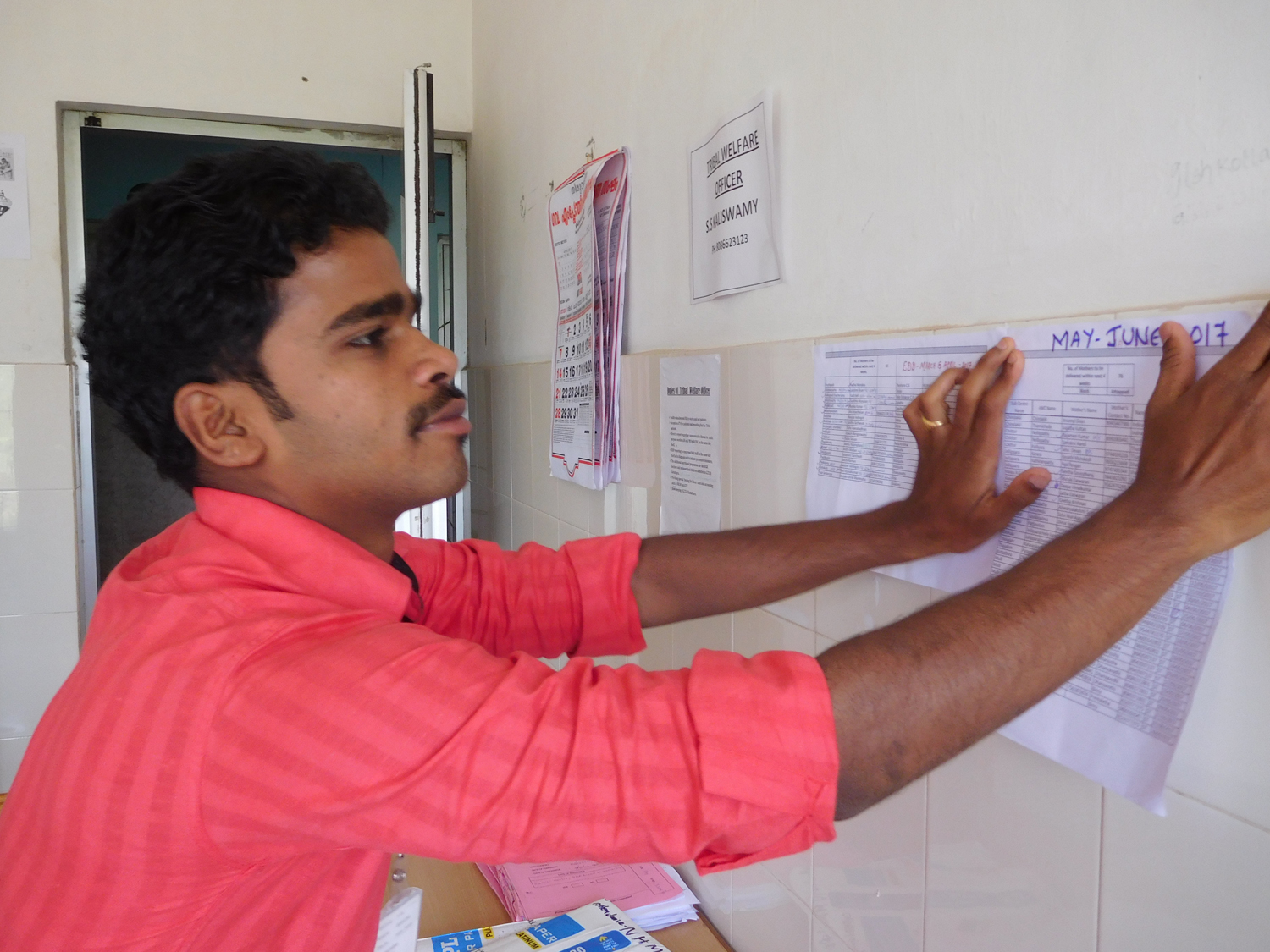 Kaliswamy, the tribal development officer at the Government Tribal Speciality Hospital, puts up a list of pregnant tribal women at his workstation.