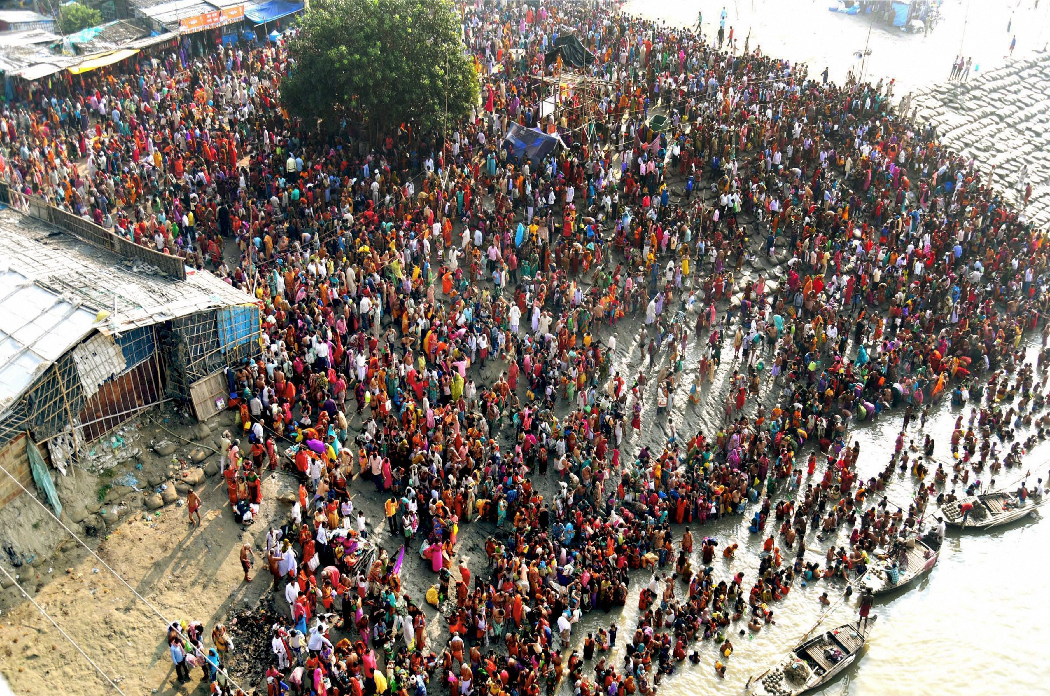 Devotees throng Bihar's Simariya Ghat in Begusarai to take a holy dip in the Ganga. Three people died in a stampede at the ghat earlier in the day. (Credit: PTI)