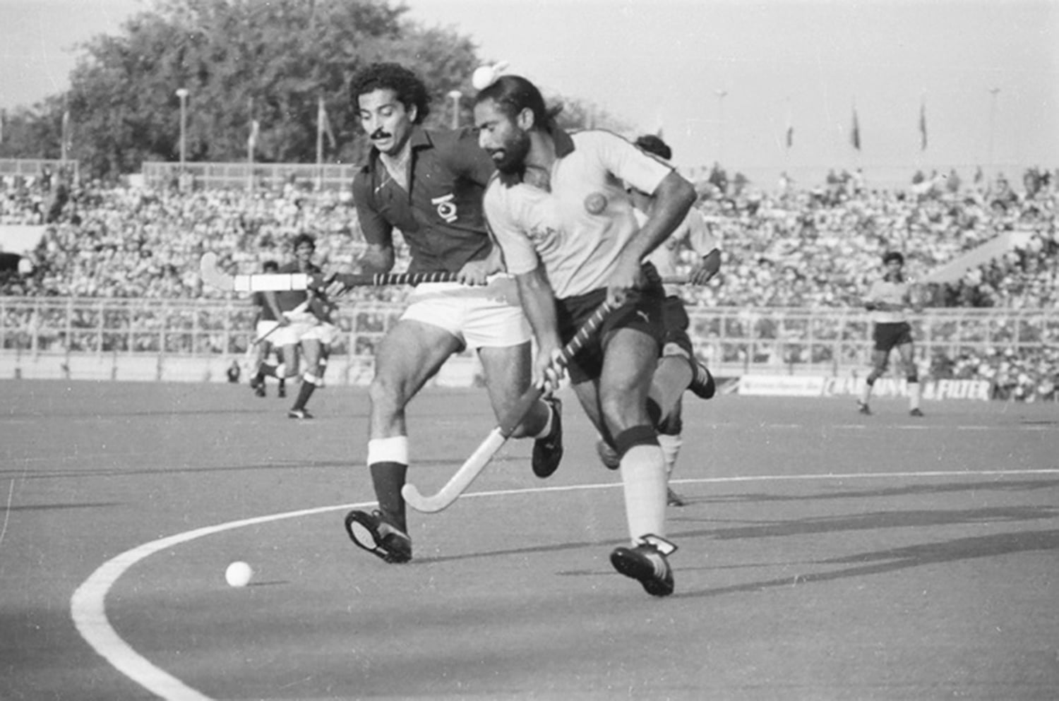Pakistan and India battle it out in the 1981 Champions Trophy at the Hockey Club of Pakistan.