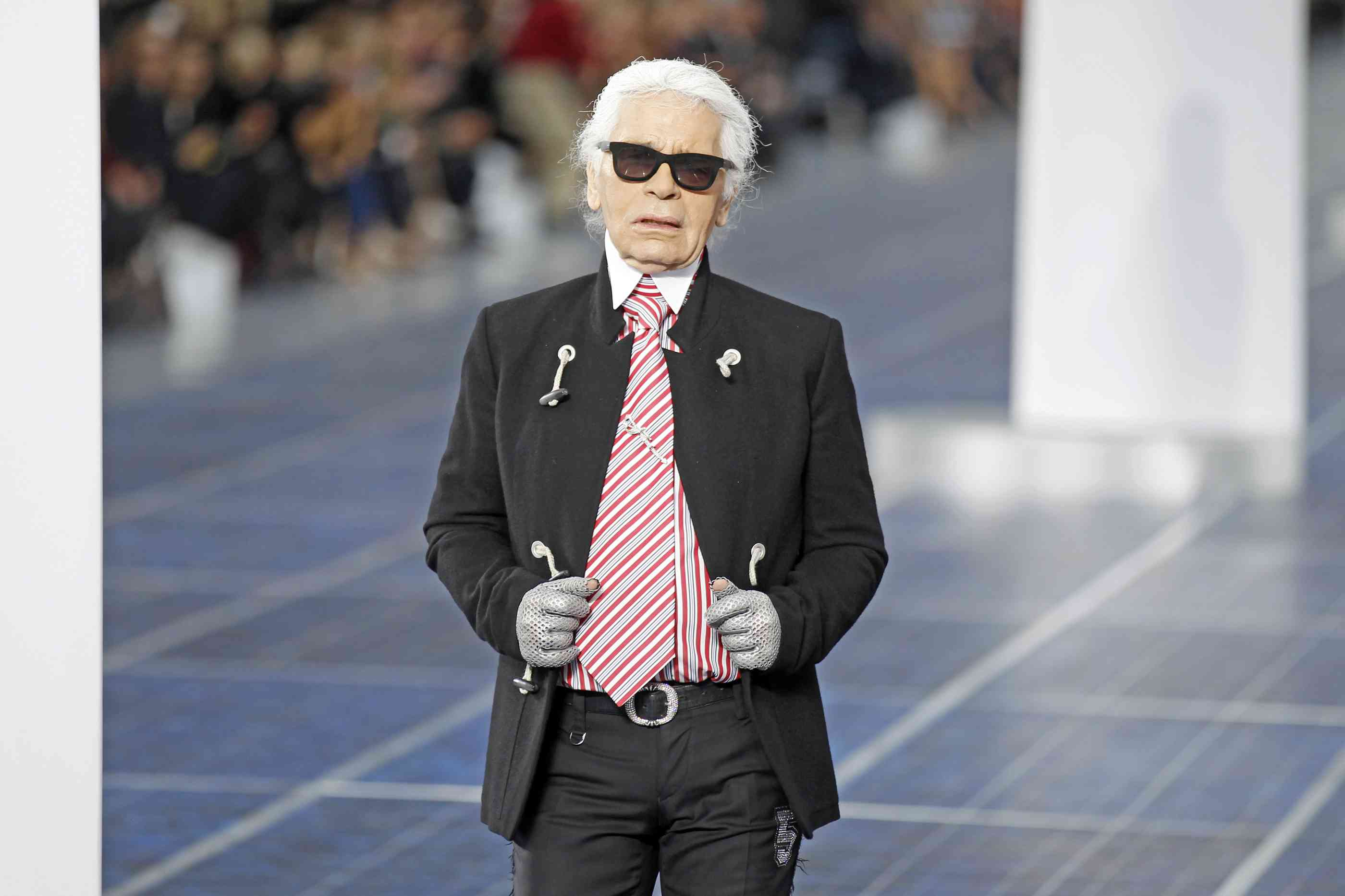 German designer Karl Lagerfeld appears at the end of his Spring/Summer 2013 women's ready-to-wear fashion show for French fashion house Chanel during Paris fashion week in 2012. Photo credit: Benoit Tessier/Reuters
