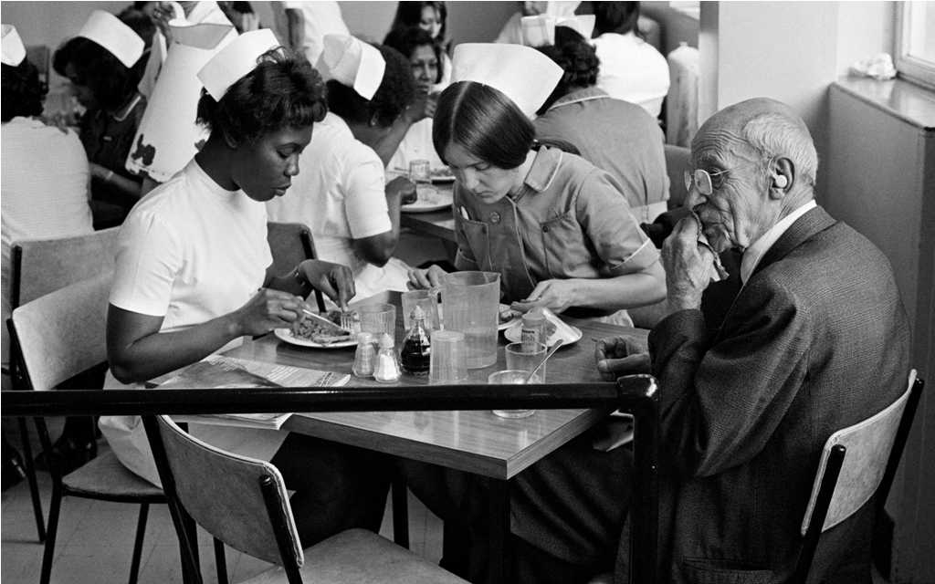 Nurses Eating Lunch, from the Migration Museum's '100 Images of Migration' exhibition © Peter Marlowe.
