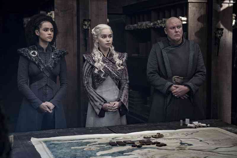 Missandei (Nathalie Emmanuel), Daenerys (Emilia Clarke) and Varys (Conleth Hill) in Game of Thrones. Courtesy HBO.