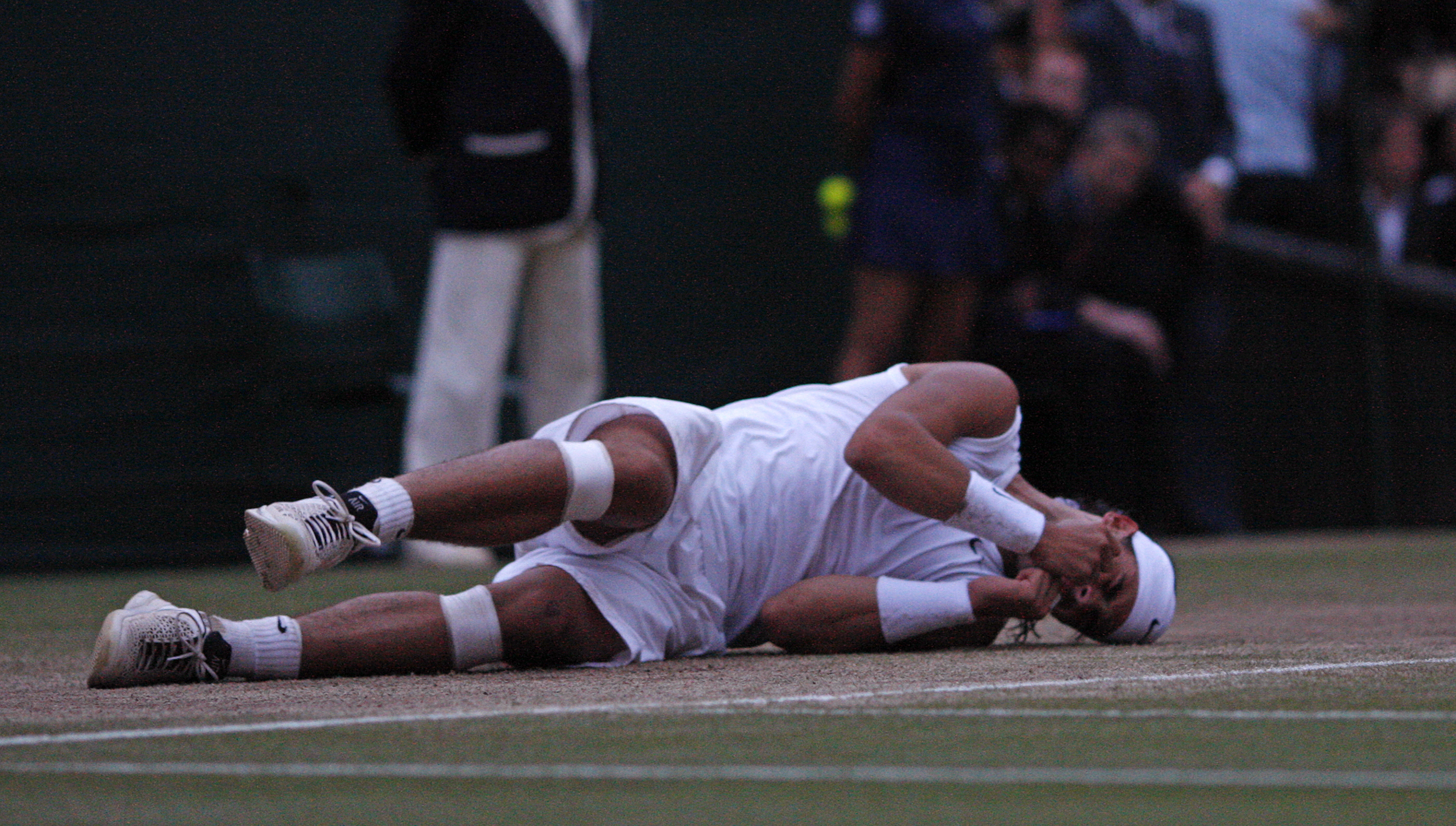Rafael Nadal collapses to the ground after winning the last point. -AFP
