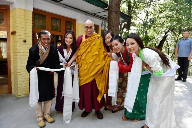 The four finalists and the organiser seek the Dalai Lama's blessings.
