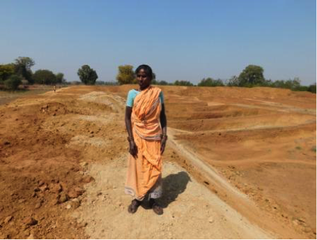 Uma Bhoi surveys a land in Bolangir, Odisha.
