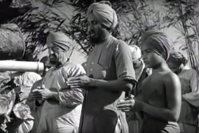 Udham Singh (centre) in a scene from Elephant Boy.