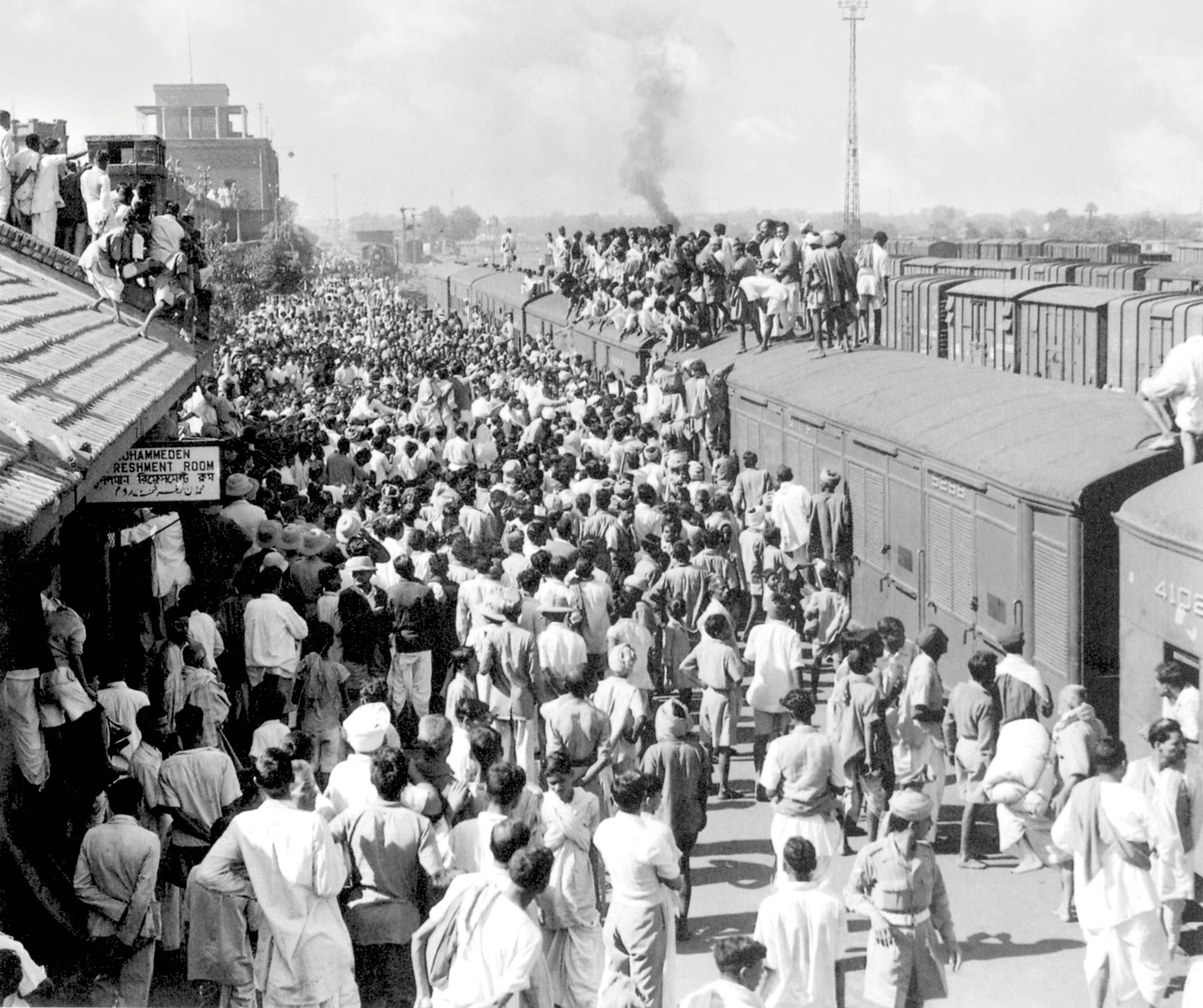 "A crowd gathers at Noakhali station to watch Gandhi arrive. Gandhi spent October 1946 in Noakhali – a district in Bengal, now in Bangladesh – in response to communal rioting. To keep the peace he later headed to Calcutta. While both Punjab and Bengal were partitioned, the latter saw little violence, some credit for which should go to Gandhi's appeal for peace. The British Viceroy of India called Gandhi a ""one-man boundary force"" for his role in pacifying Calcutta. Credit: Alamy"