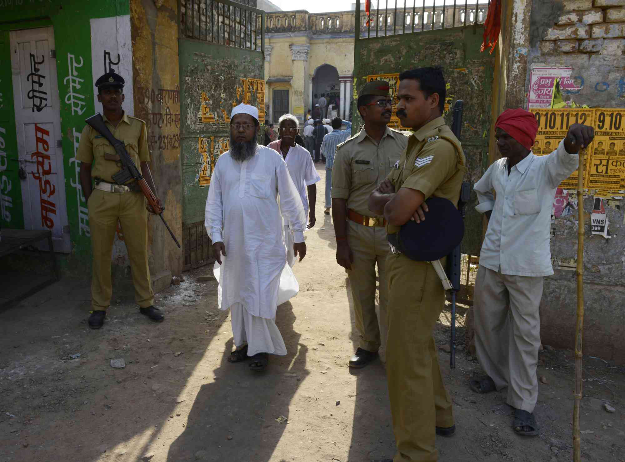 A Muslim voter exits a local polling station after casting his ballot in Varanasi on May 12, 2014. (Photo credit: Roberto Schmidt/AFP).