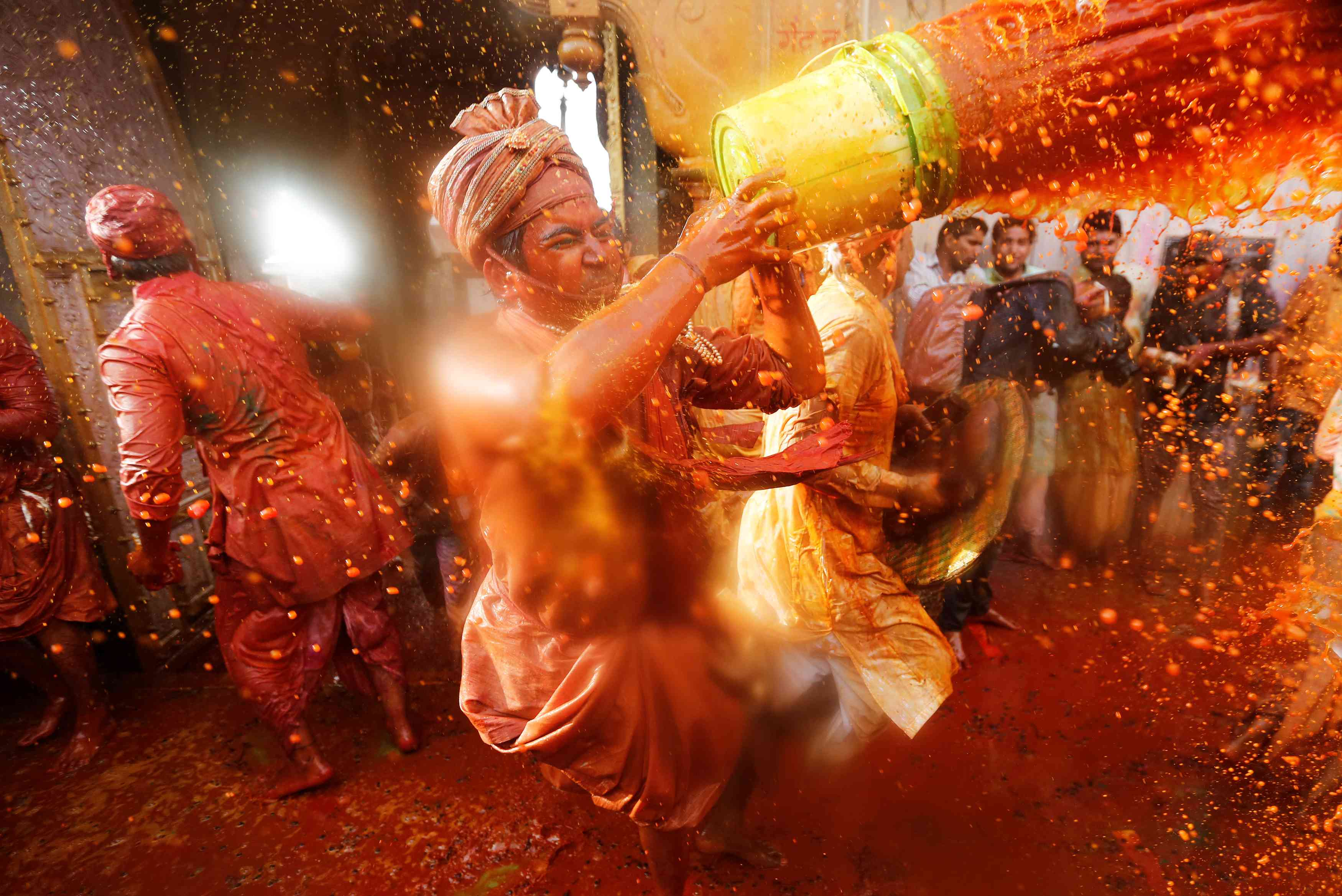 Devotees take part in Holi celebrations inside a temple in Nandgaon village of Uttar Pradesh. | Credit: Reuters