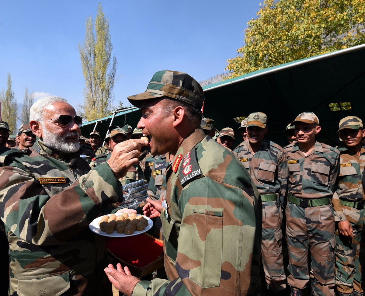 Prime Minister Narendra Modi celebrated Diwali with soldiers in the border town of Gurez, Jammu and Kashmir. (Credit: IANS)