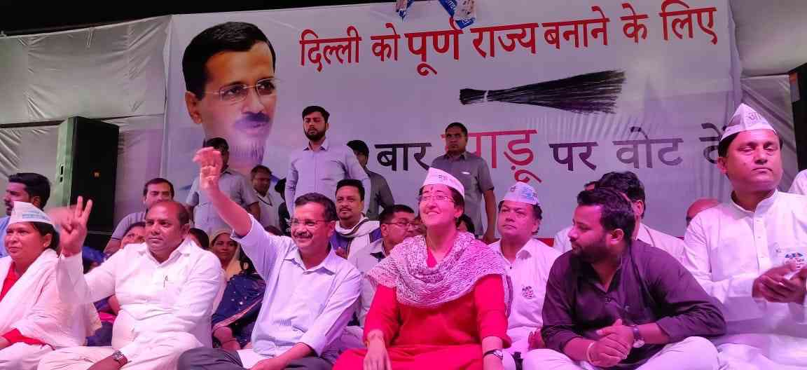 Arvind Kejriwal with AAP East Delhi Lok Sabha candidate Atishi at a rally. (Photo credit: AAP media cell).