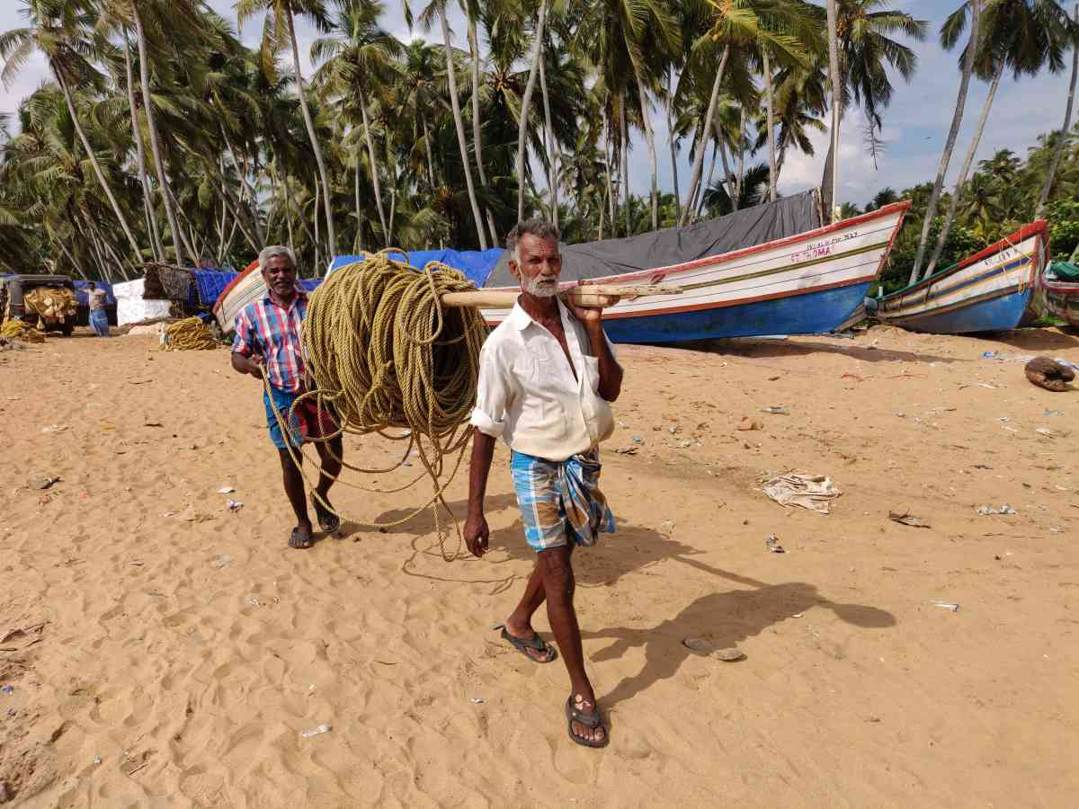 Fishermen prepare for their next trip in Poonthura village.