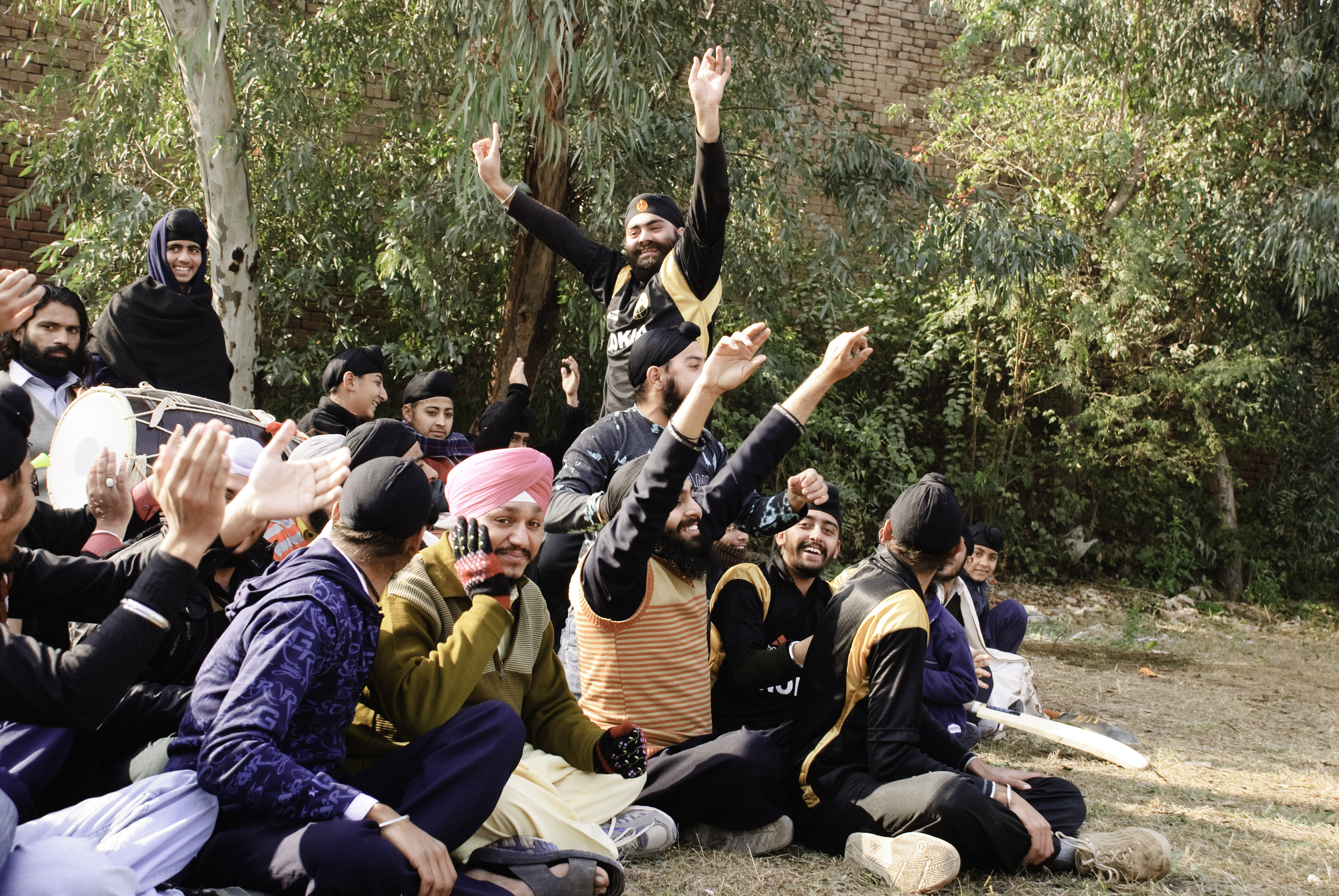 Players and spectators watch the final match. Photo credit: Faisal Saeed