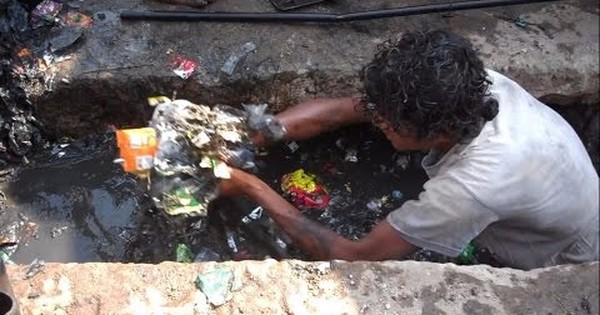 Watch: In 'manual scavenging free' Gujarat, workers have to clean sewage without any protective gear