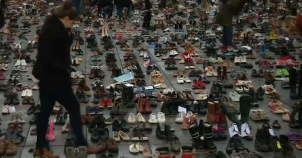 Twenty thousand pairs of shoes lead the protest at Paris Climate Summit as humans are kept away