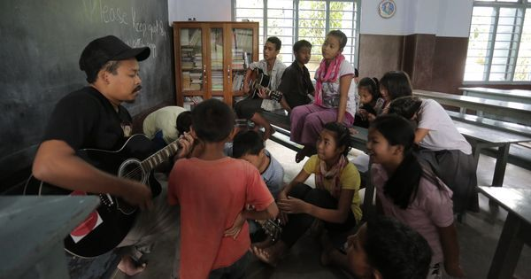 A musician is building peace in Manipur, with the help of some children and a guitar