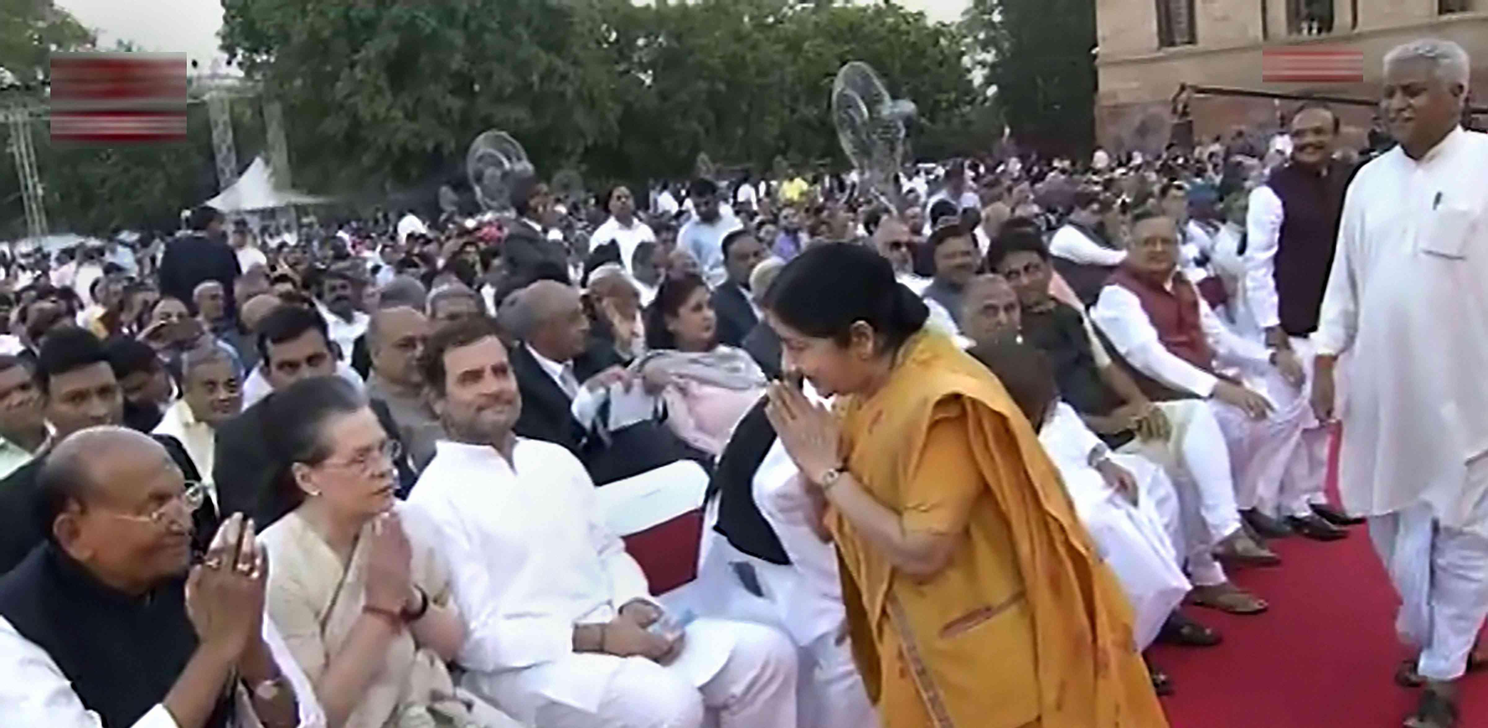 Senior BJP leader Sushma Swaraj exchanges greetings with senior Congress leader Sonia Gandhi and Congress President Rahul Gandhi. (Image Credit: PTI)