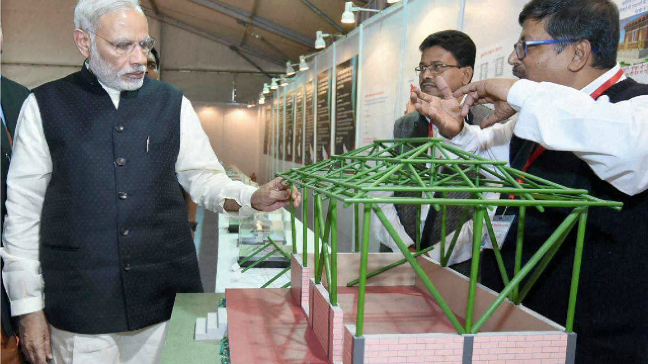 Prime Minister Narendra Modi visiting an exhibition at the launch of Pradhan Mantri Awas Yojana (Rural) in Agra, Uttar Pradesh in 2016. Photo: PTI