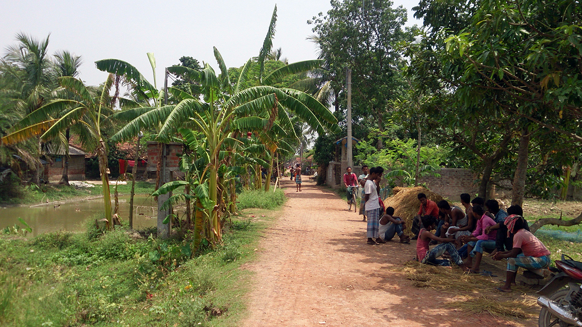 Local residents guard the road leading to their village.