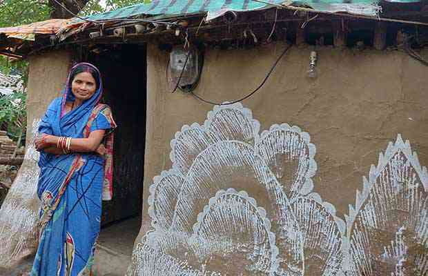 "Dayamanti Biswal, 48, has to rebuild her mud home every year after the monsoon like most of her neighbours in Bhadrak, Odisha. She has thought of moving away but cannot afford to do so but said, ""I ensured all my daughters were educated and sent them away from this misery as soon as I could."" Photo credit: Disha Shetty"