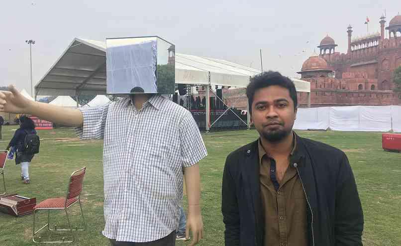Aadit Basu stands next to his art installation in Delhi. Photo credit: Vijayta Lalwani