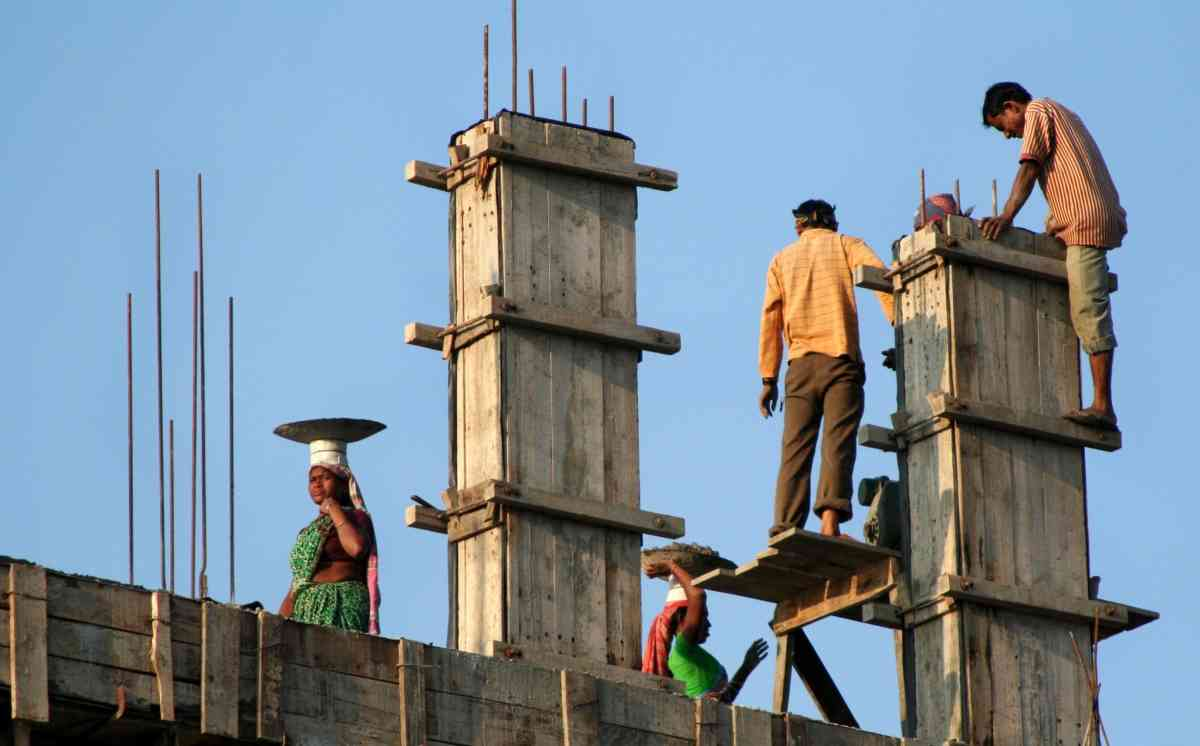Construction labourers at work in Siliguri, West Bengal. (Photo credit: AFP/Diptendu Dutta).