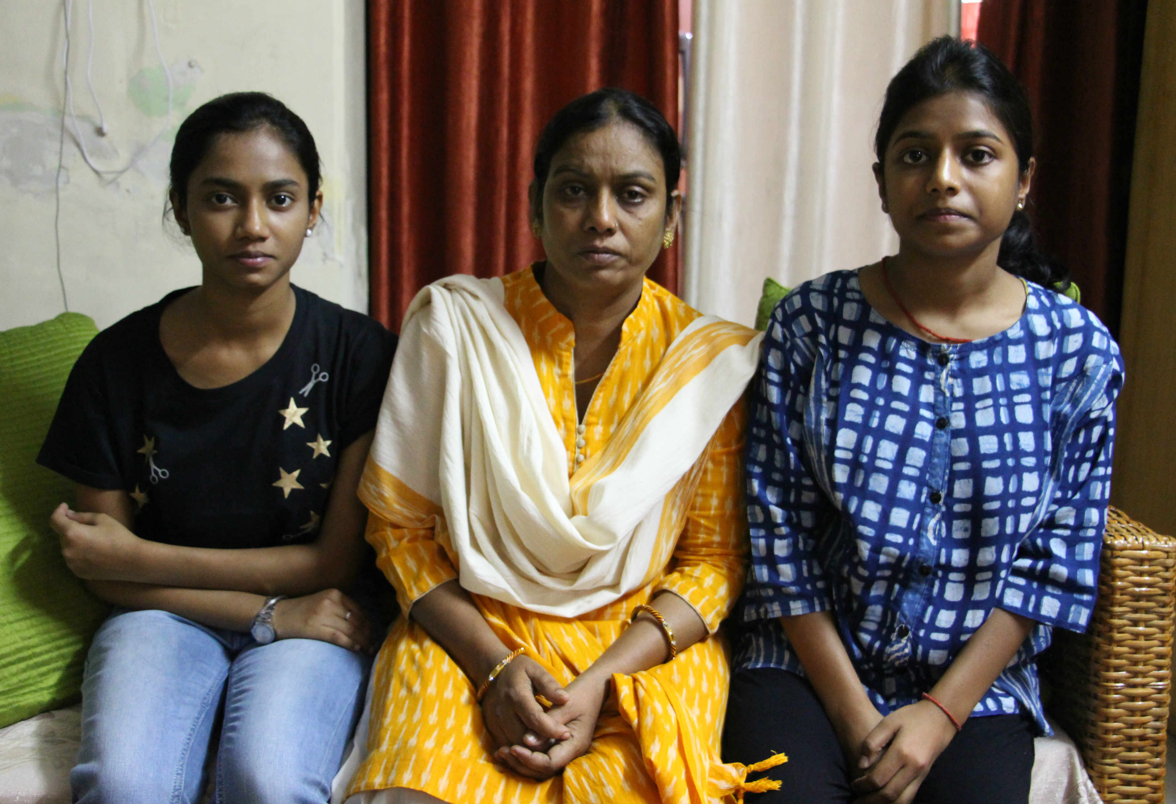 Taruna with her daughters at their home in Ghazipur. Photo credit: Aabid Shafi