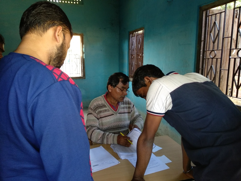 Checking the list at a seva kendra in Goalpara district. (Photo credit: Arunabh Saikia).