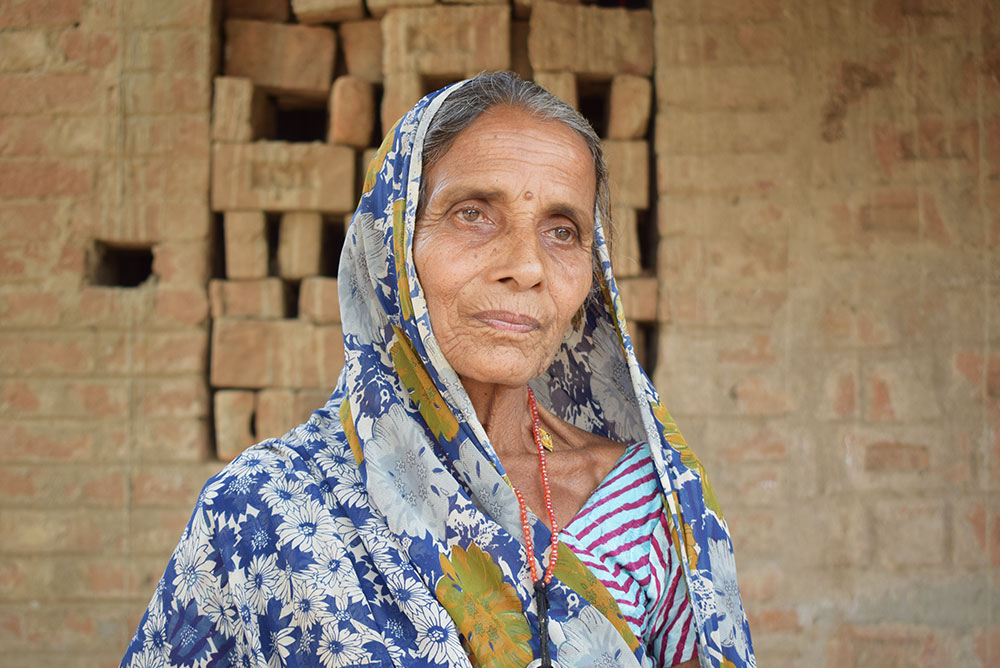 """We won't give our land to Adani, even if they kill us, let them kill us on our plots. When I lost my husband early, what I made from the land helped me raise my children,"" said Gayatri Devi, 75, from the village of the Sondiha, who had fasted for seven days in protest against the Adani project. ""This is our dharti mata [Mother Earth]. It has raised us. Our ancestors made this land cultivable with great difficulty, why would we leave it?"""