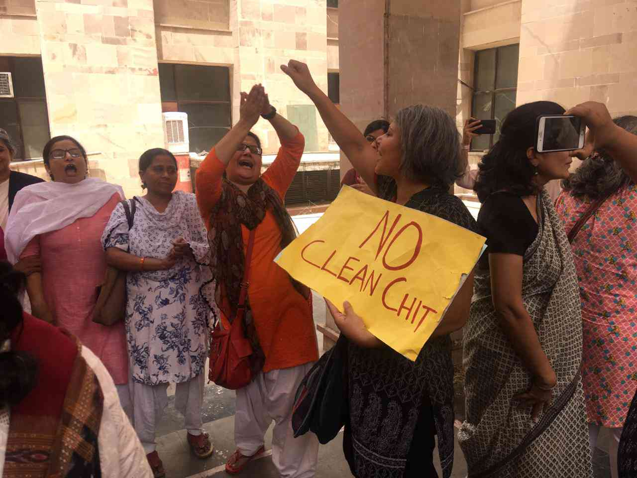 Inside the police station, women raised slogans against the inquiry committee's findings.